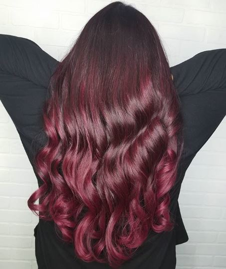 Woman with long brown and burgundy ombre hair