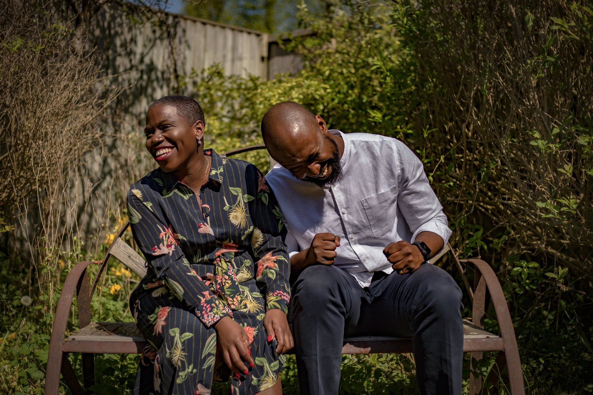 black woman and man sitting and laughing together