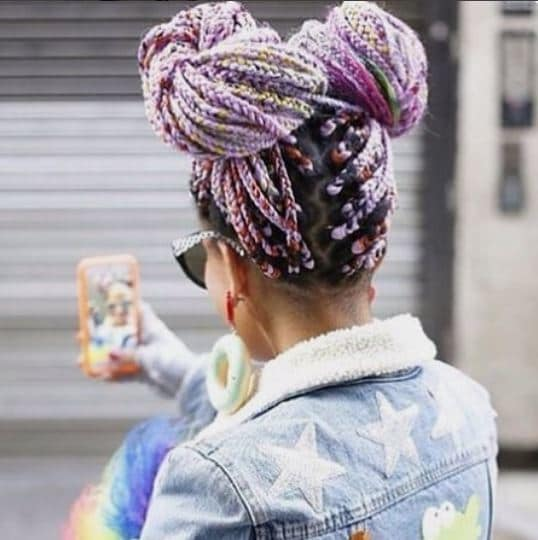 woman with purple braided space buns