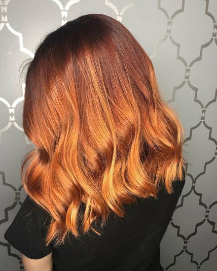 Woman with copper ombre wavy hair