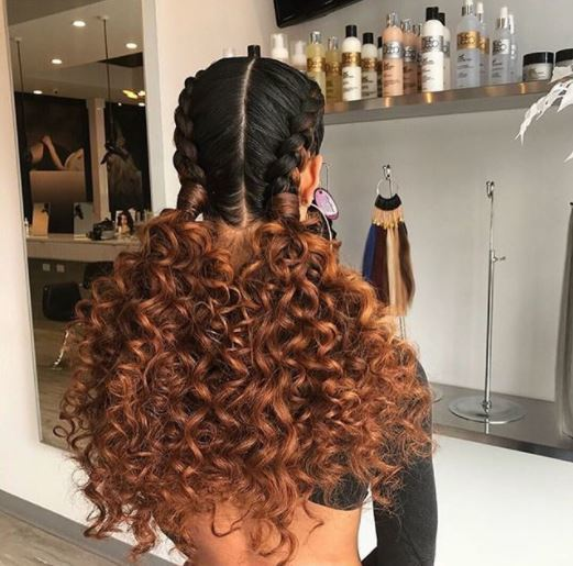 woman with curly hair in double french braids