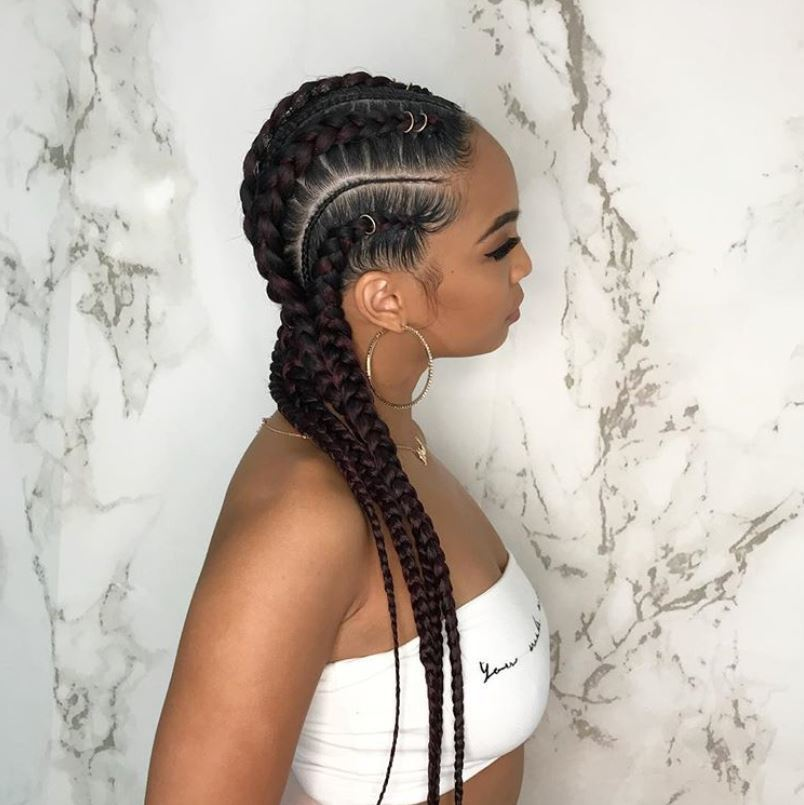 Woman with feed in long cornrow braids
