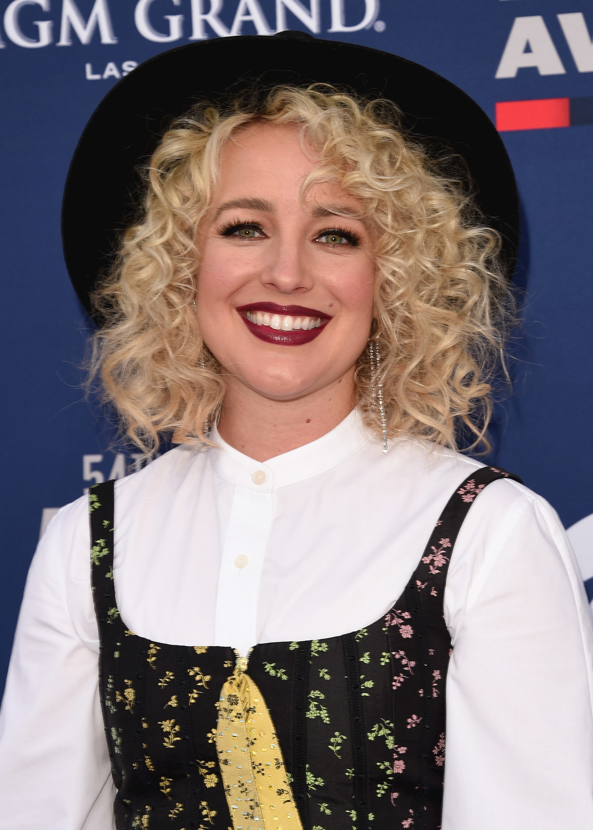 Woman with blonde curly shoulder length hair
