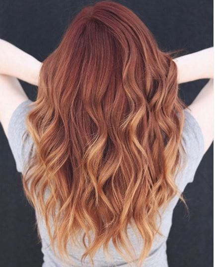 Woman with ginger wavy ombre hair