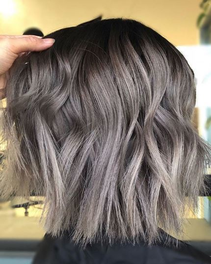 woman with wavy grey ombre shoulder length hair