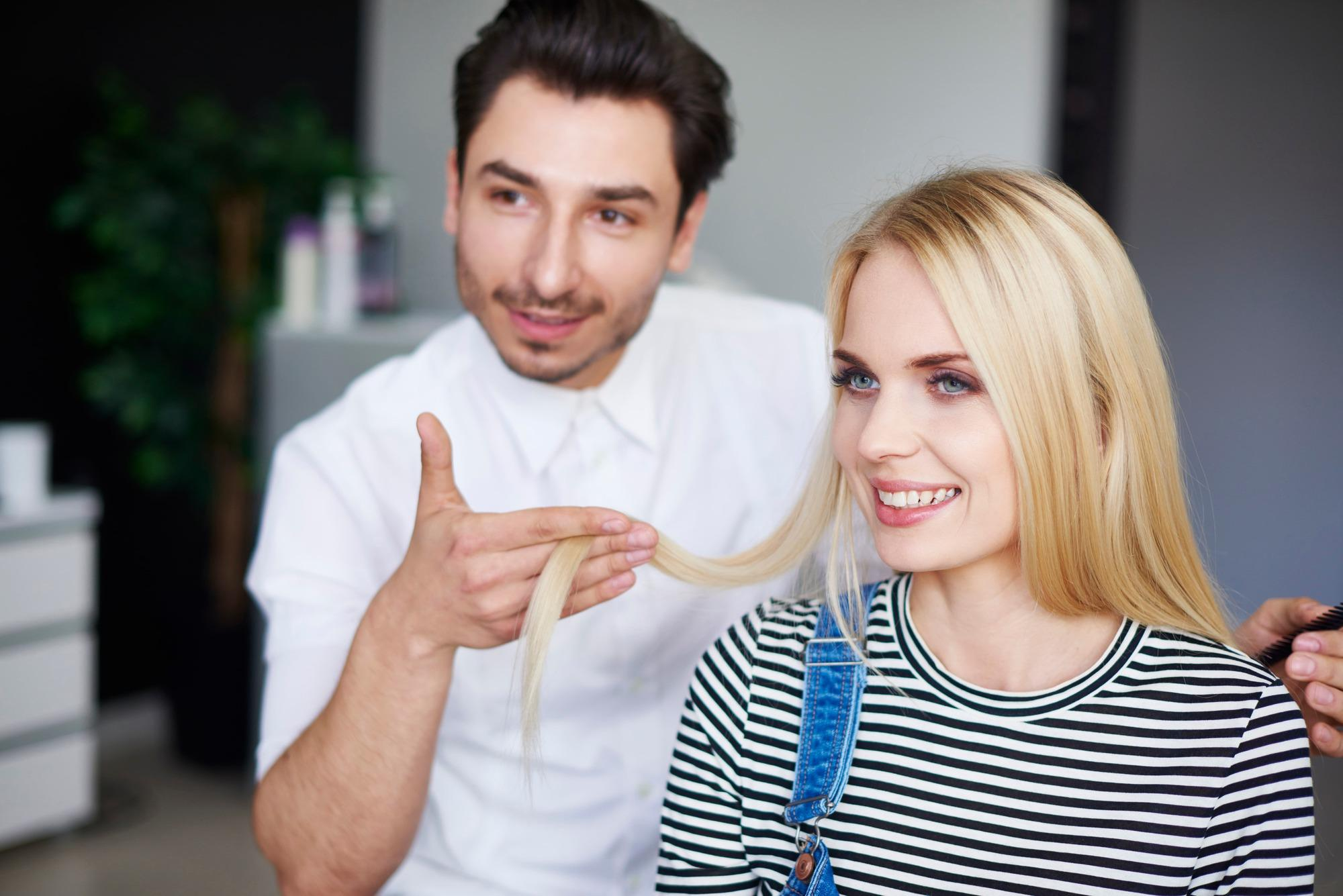woman getting her hair assessed by a hair stylist