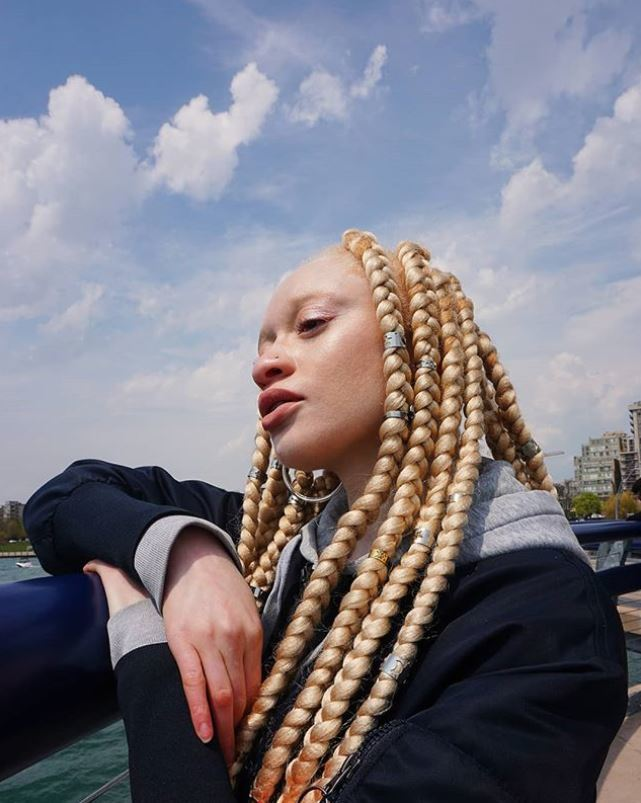 Woman with long blonde jumbo box braids