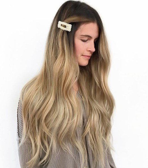 Woman with very long wavy blonde balayage hair