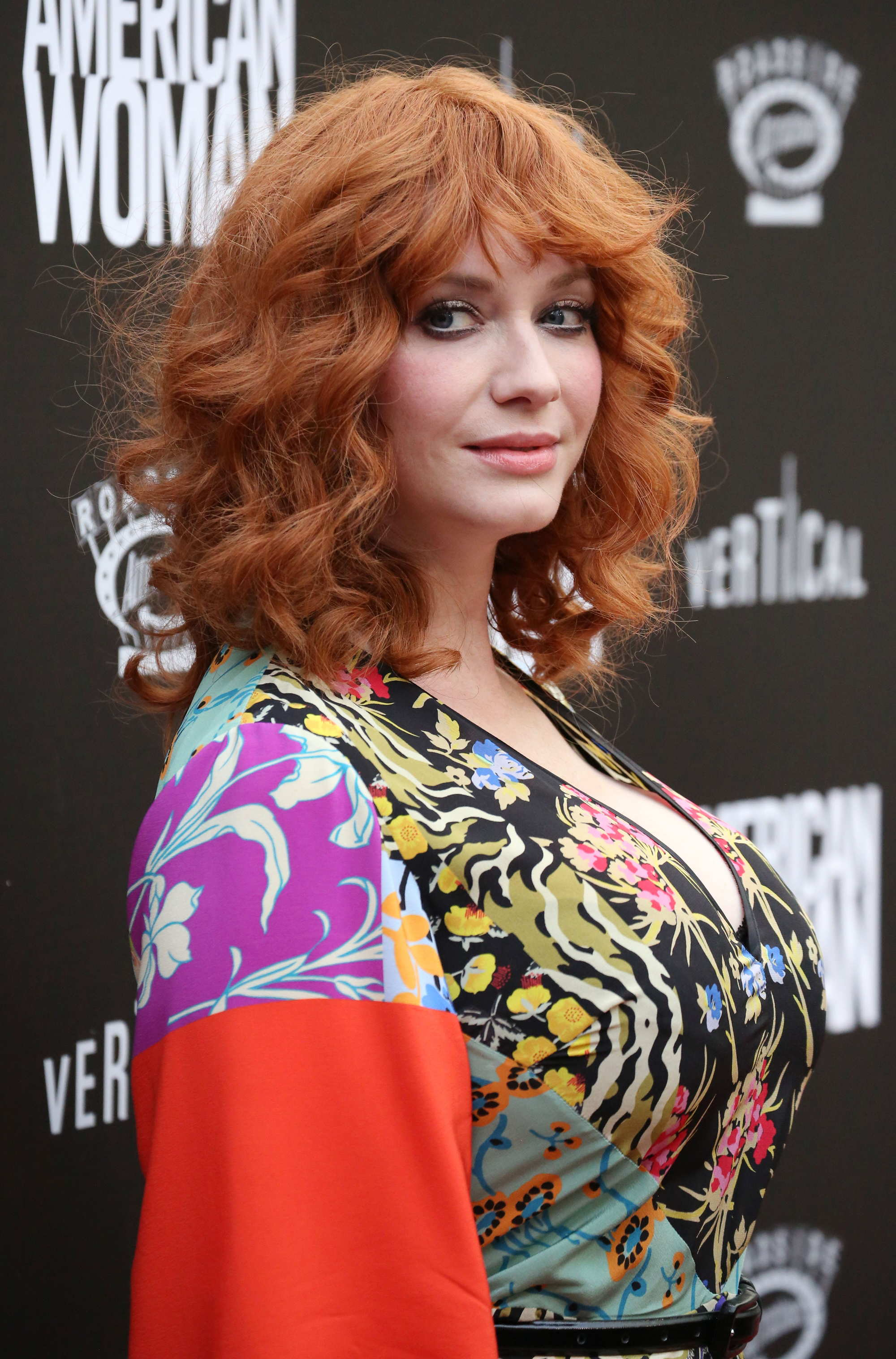 Christina Hendricks with curly red hair and bangs