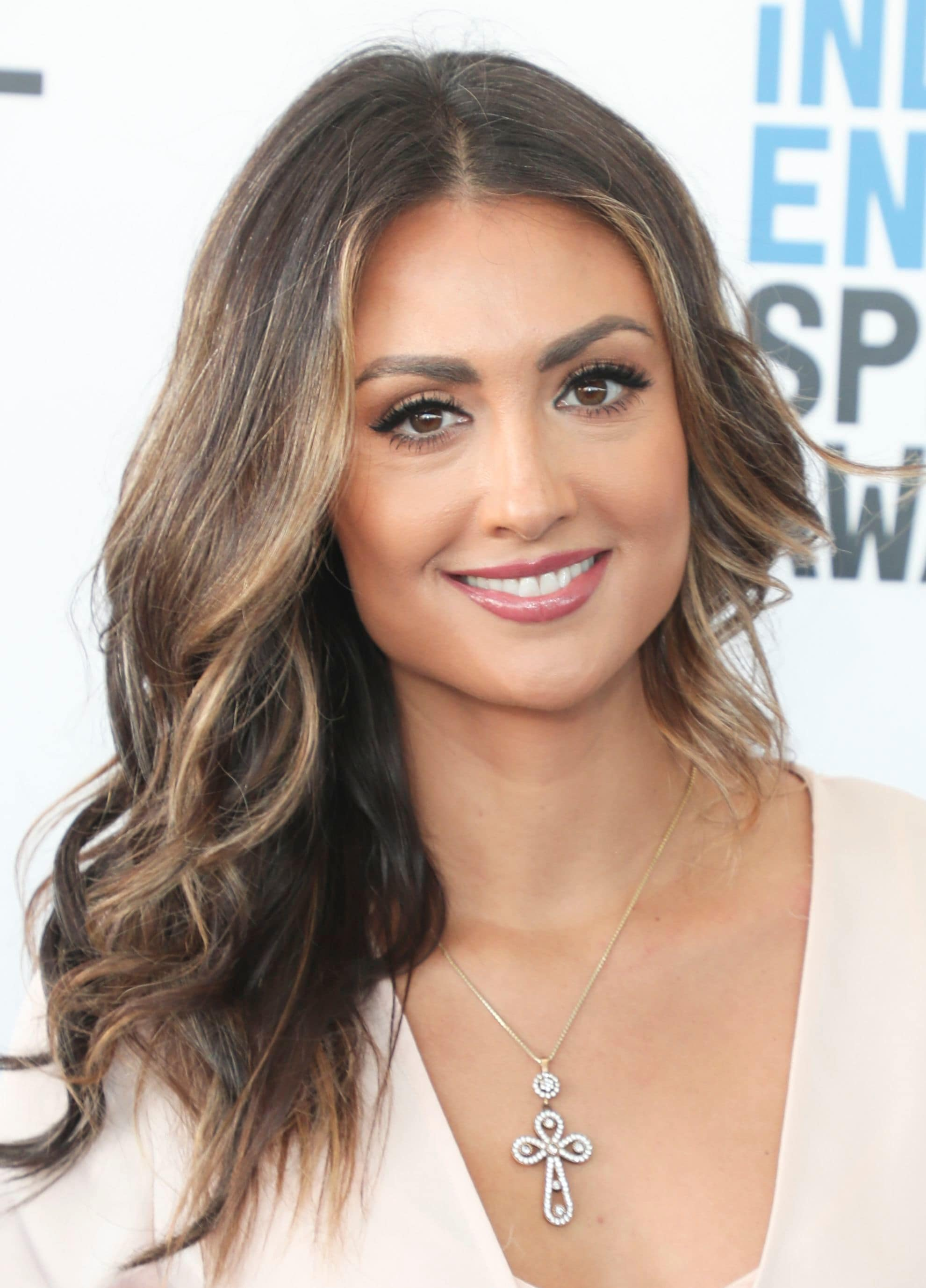 Katie Cleary with long brown wavy hair