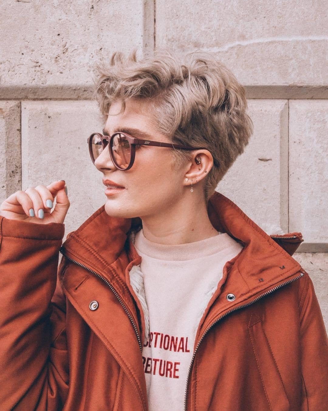 woman with ash blonde pixie haircut