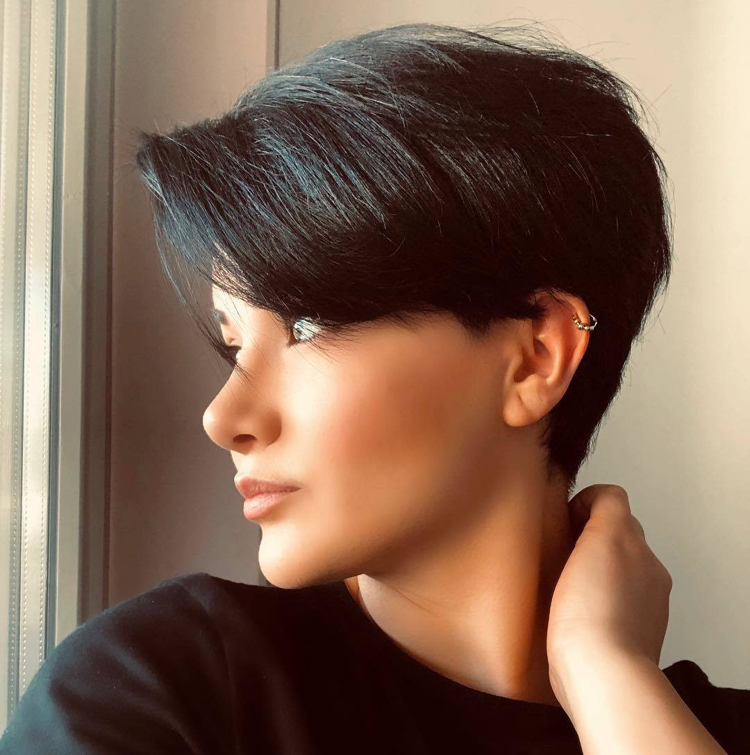 woman with brunette pixie cut
