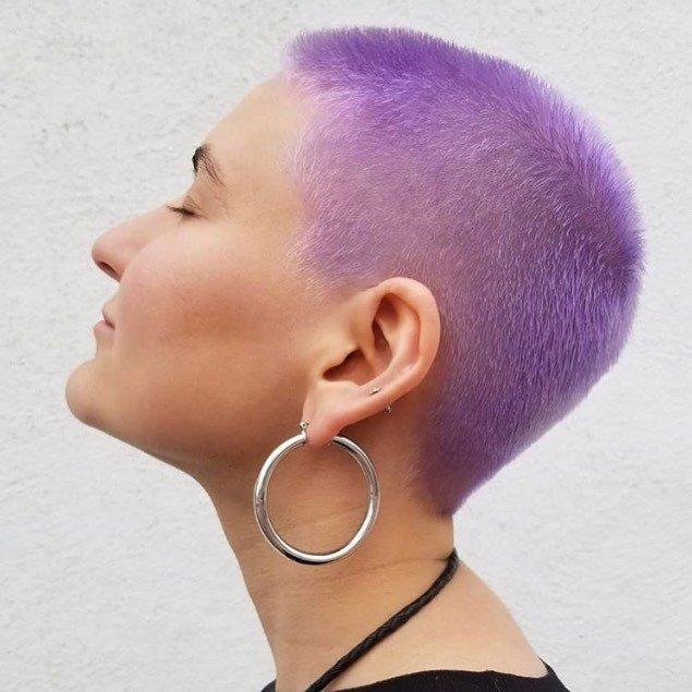 woman with a purple buzz cut pixie hairstyle