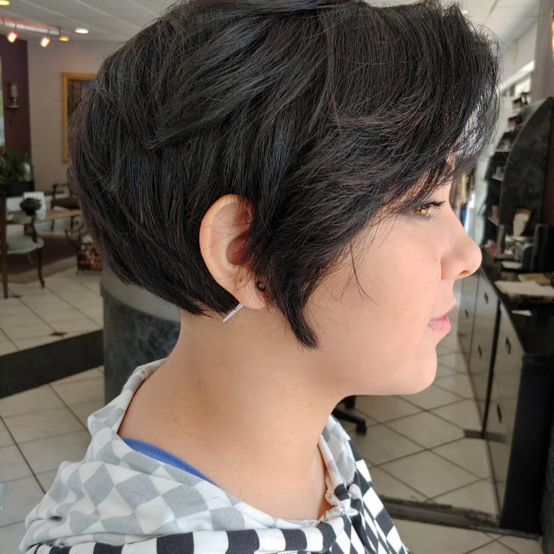 woman with layered dark brown pixie haircut