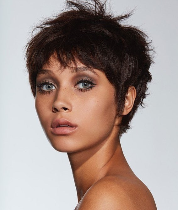 woman with dark brown messy 60s pixie haircut