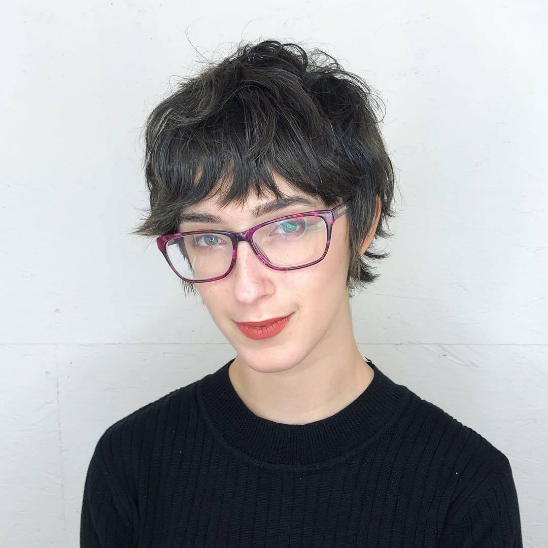 woman with dark brown shaggy pixie haircut
