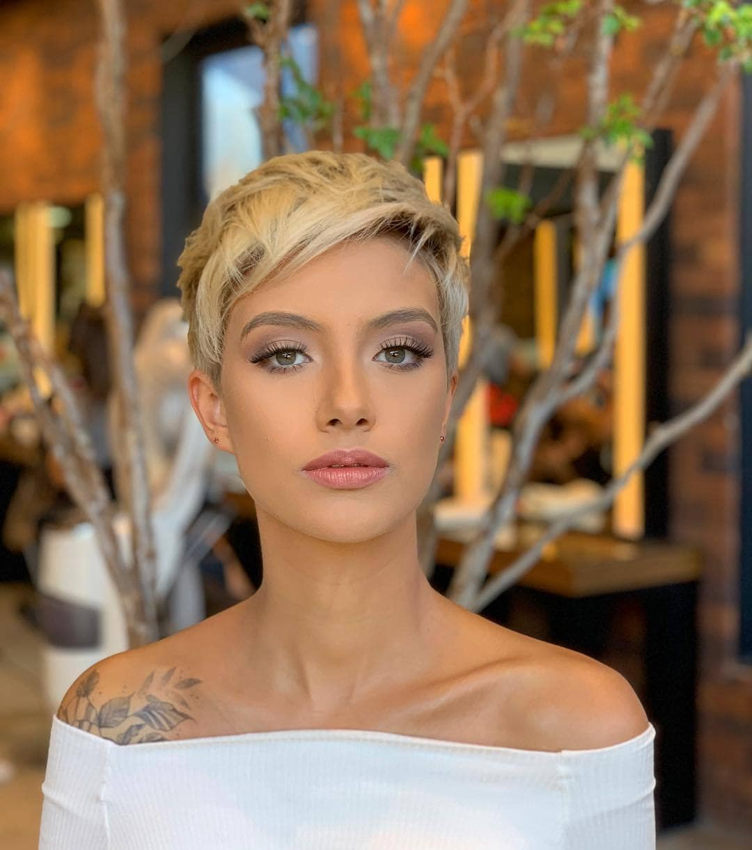woman with short blonde pixie cut hairstyle