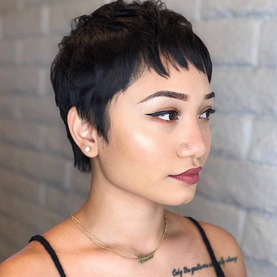 woman with dark textured pixie haircut