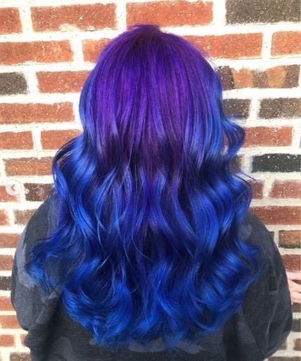 woman with purple and blue wavy ombre hair