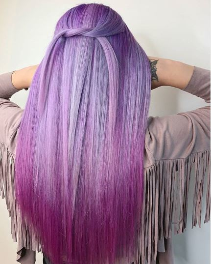 Woman with long purple ombre hair