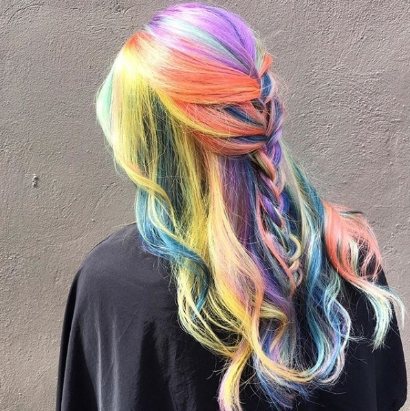 Woman with long rainbow hair in half-up braid