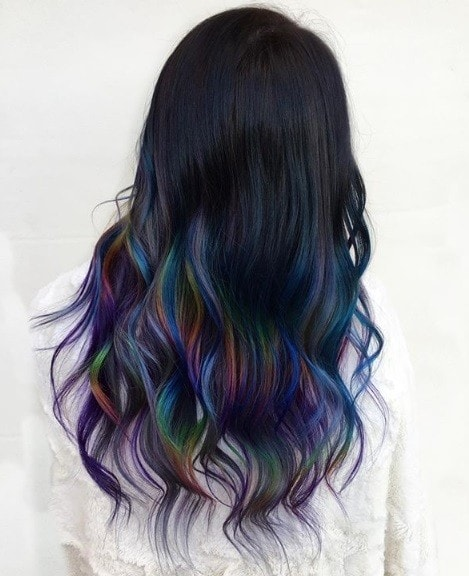 Woman with long dark rainbow hair