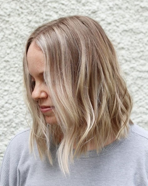 Woman with a light blonde balayage bob