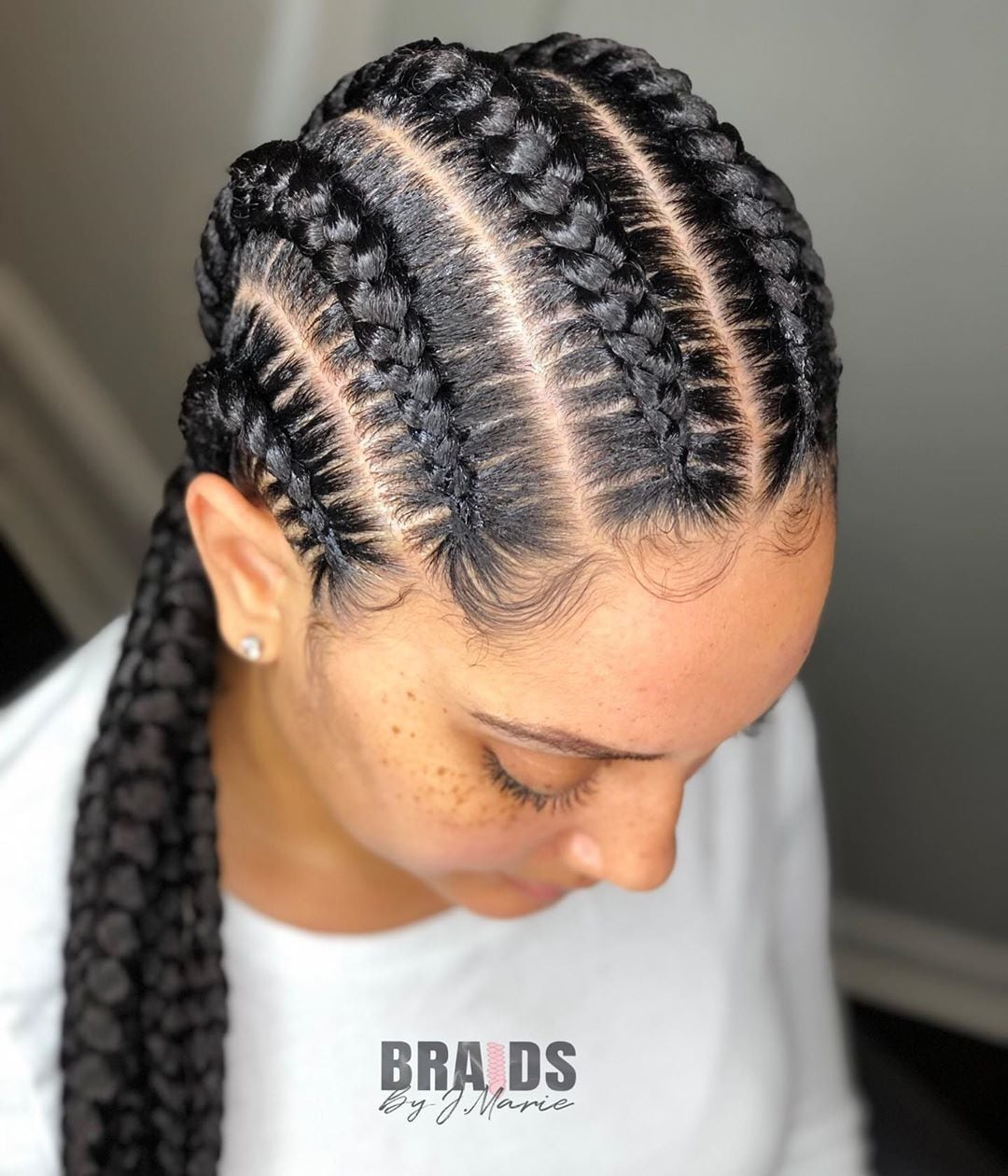 close up of woman with stitch braided cornrows