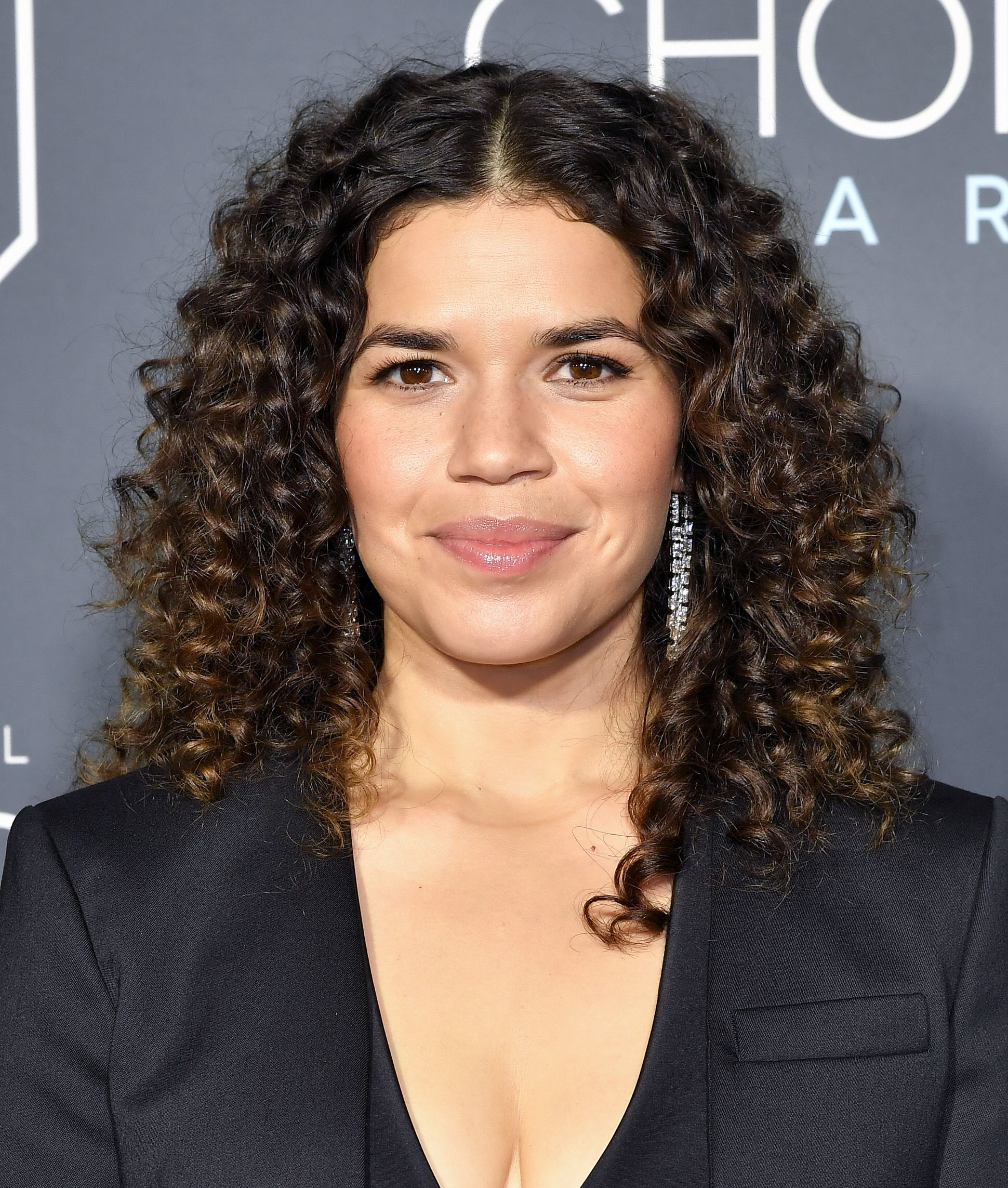 America Ferrera with shoulder length curly brown hair