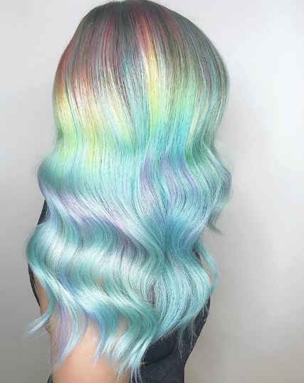 Woman with long wavy rainbow hair