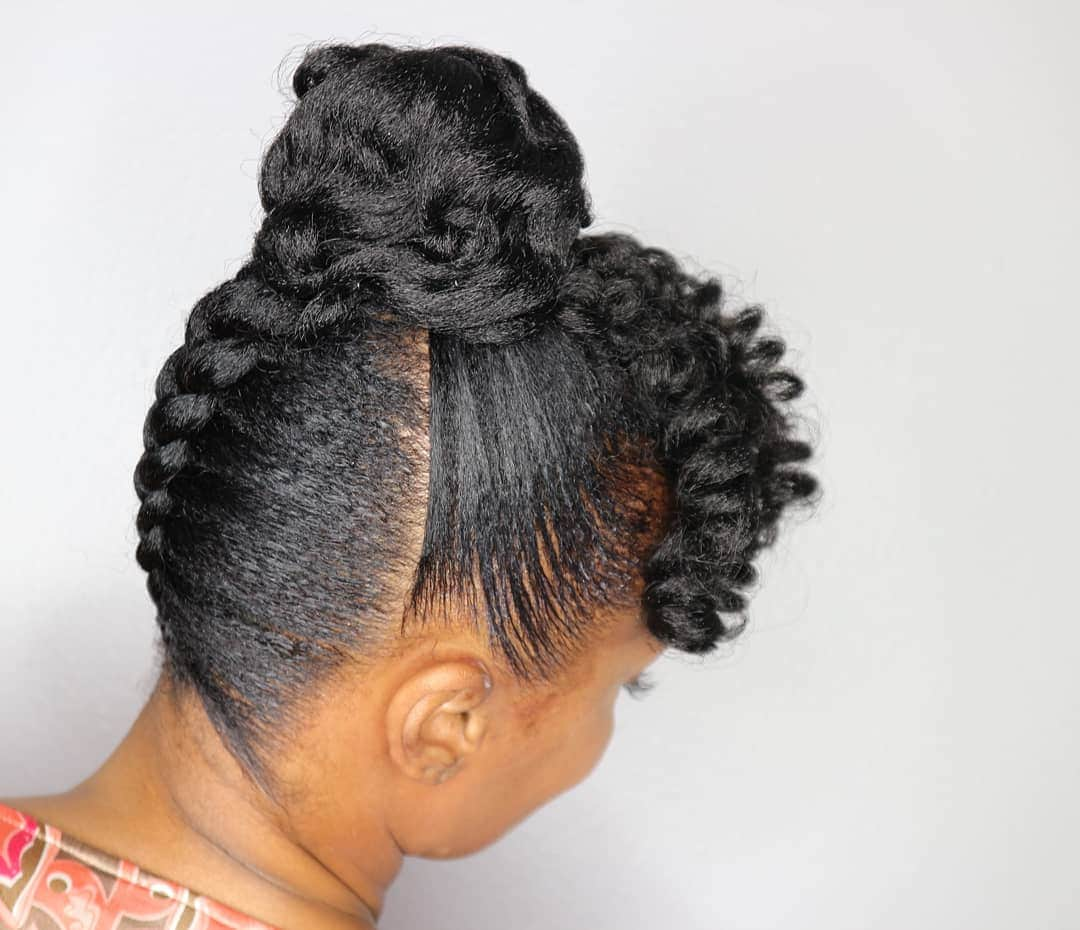 woman with natural black hair styled into upside down braid