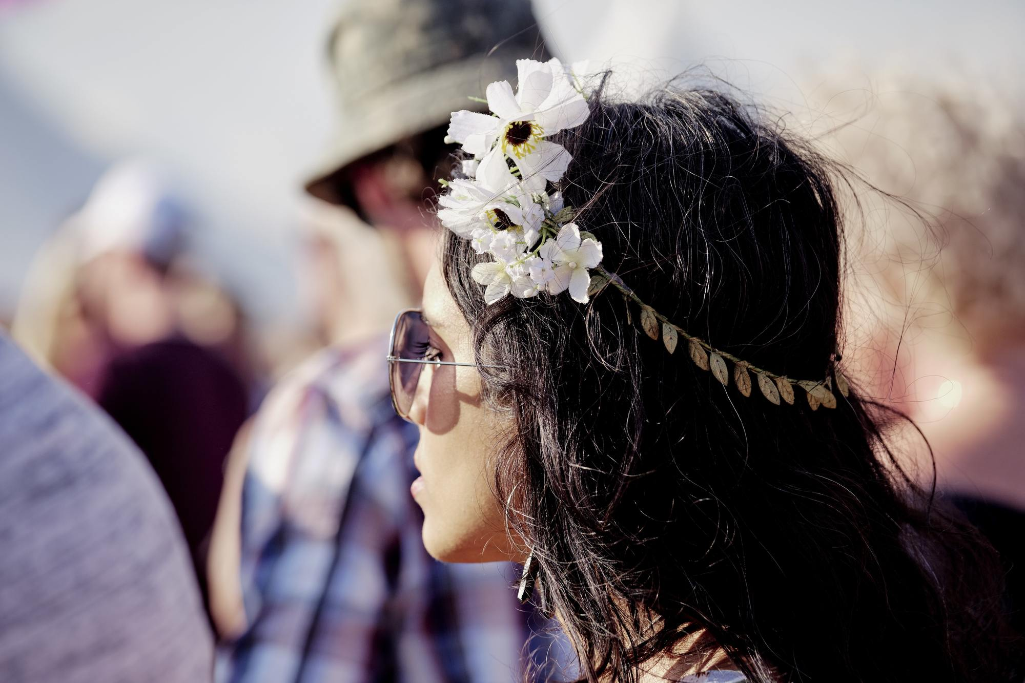 side view of a woman wearing a flower headband