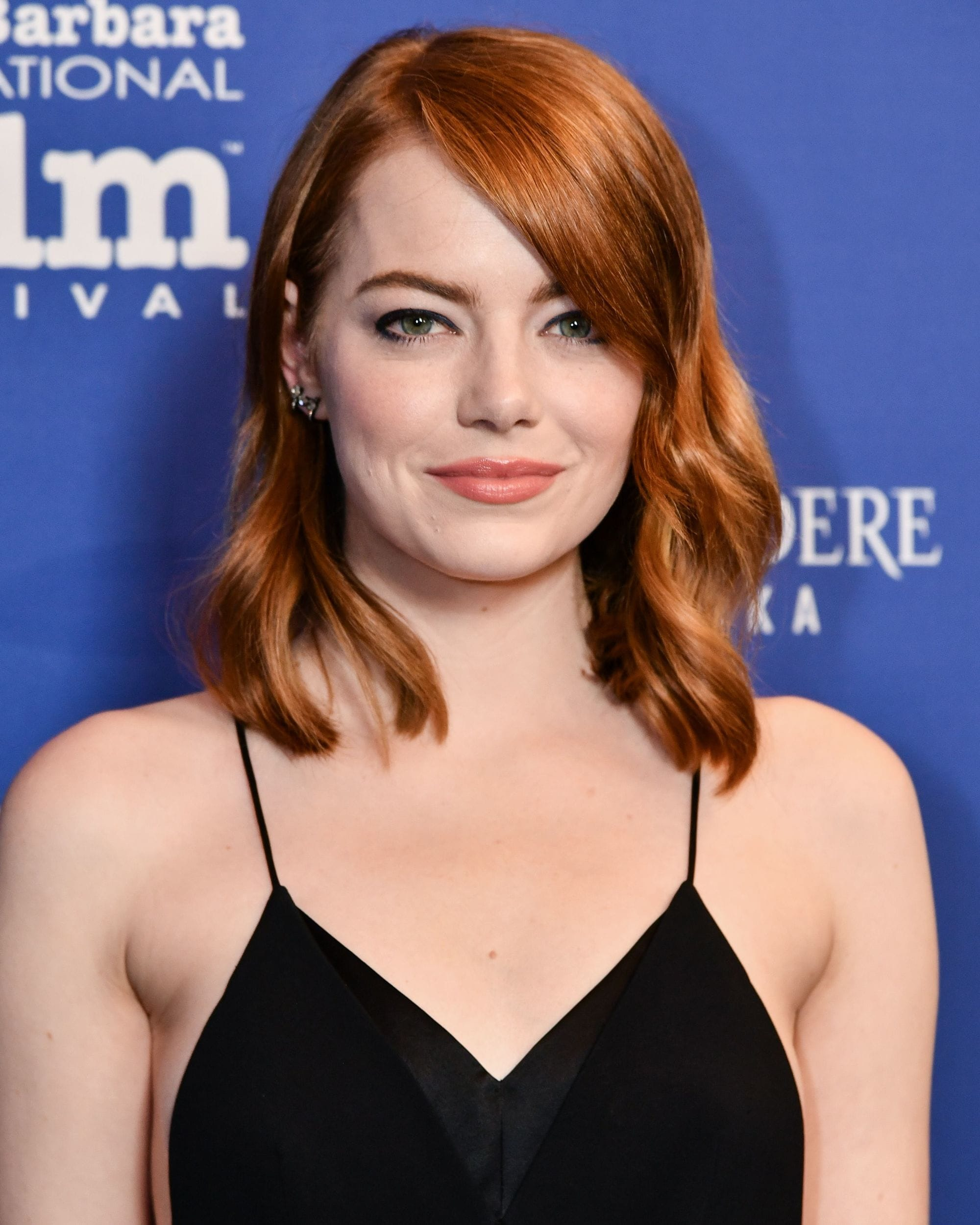 Emma Stone with an auburn wavy lob
