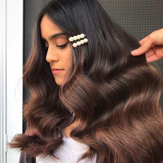 Woman with balayage on long brown hair