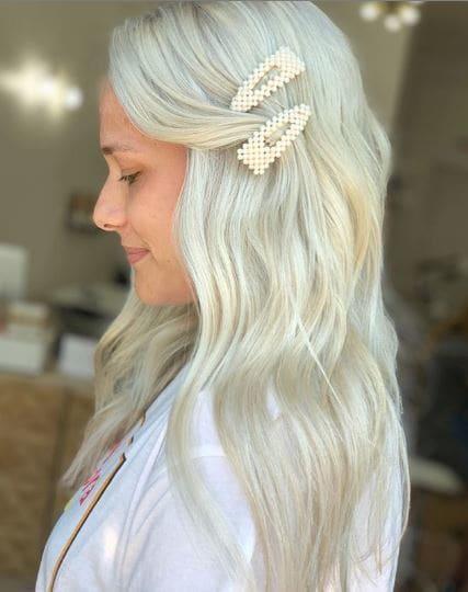 Woman with bleach blonde wavy long hair