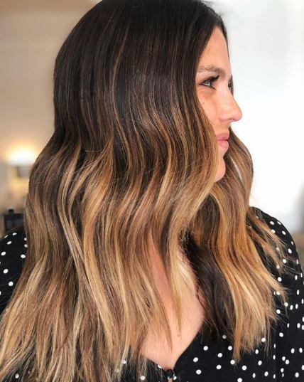 Woman with brown balayage wavy hair