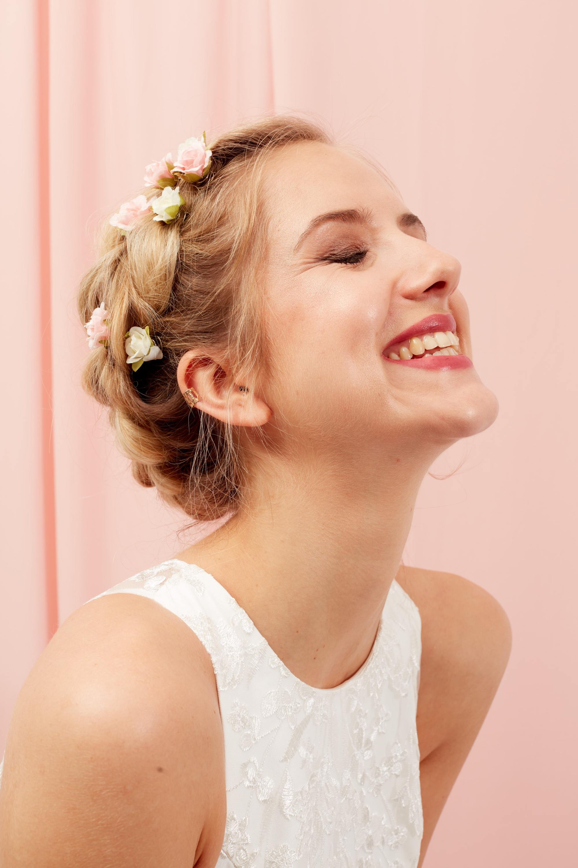 Blonde woman wit halo braid and flowers