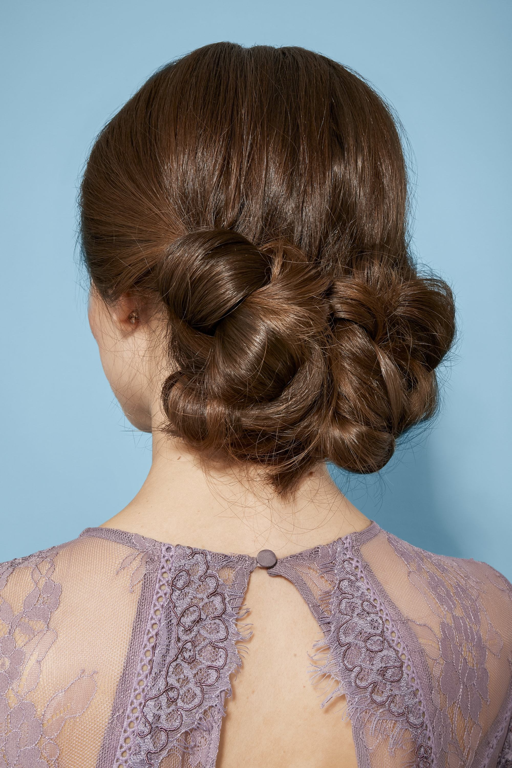 Brunette with low chignon updo