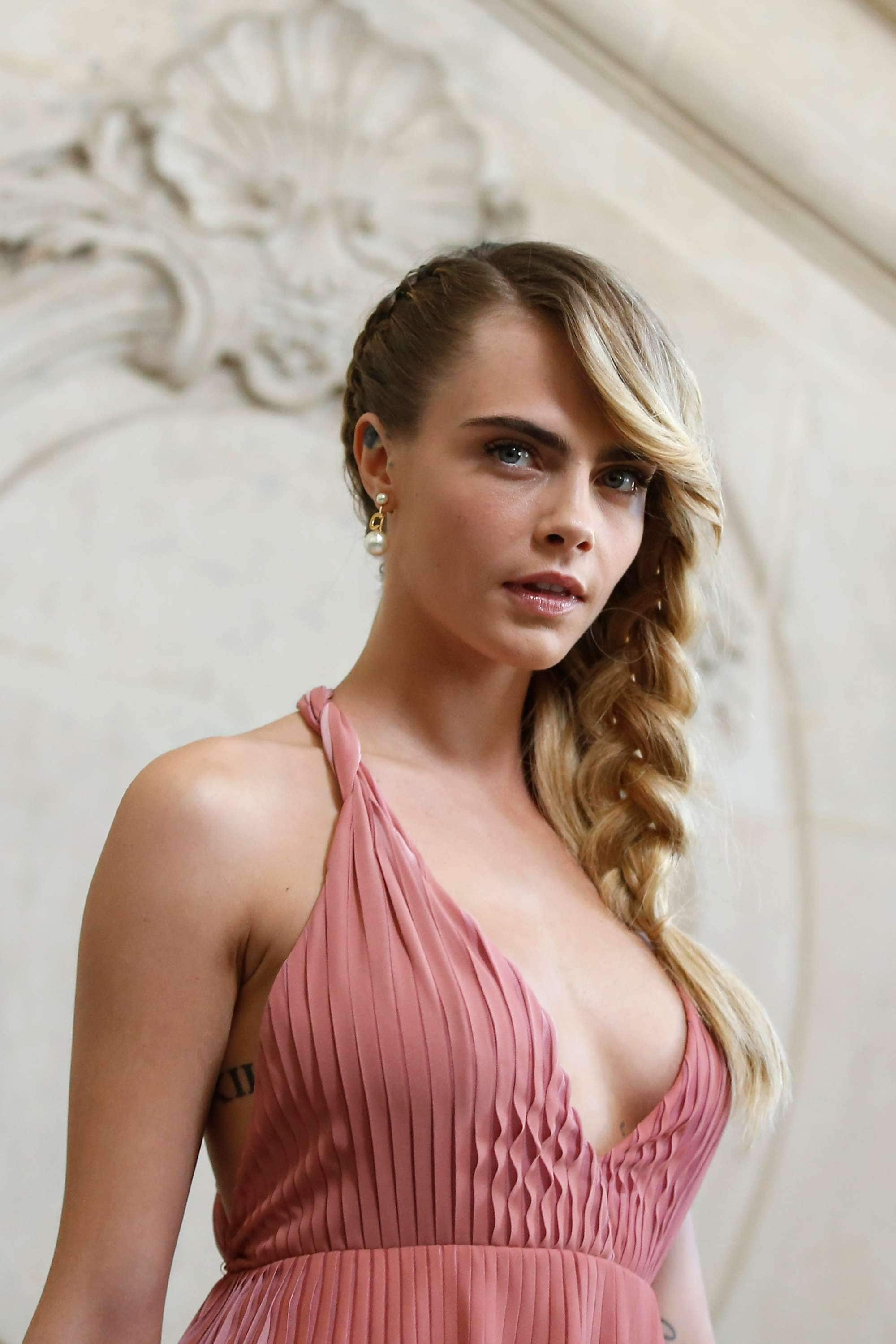 Cara Delevingne with blonde side braid