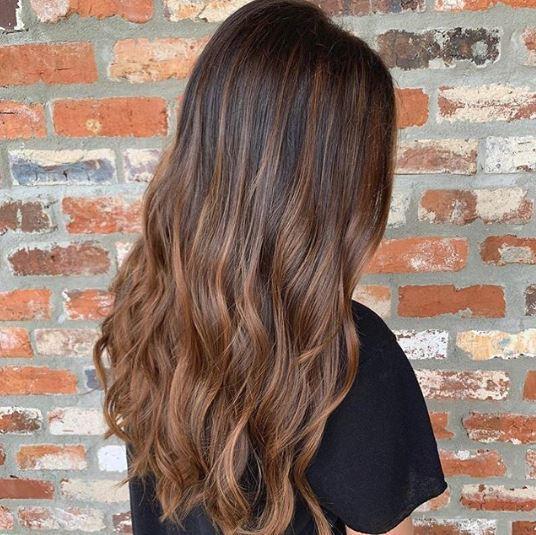 Woman with brown balayage hair