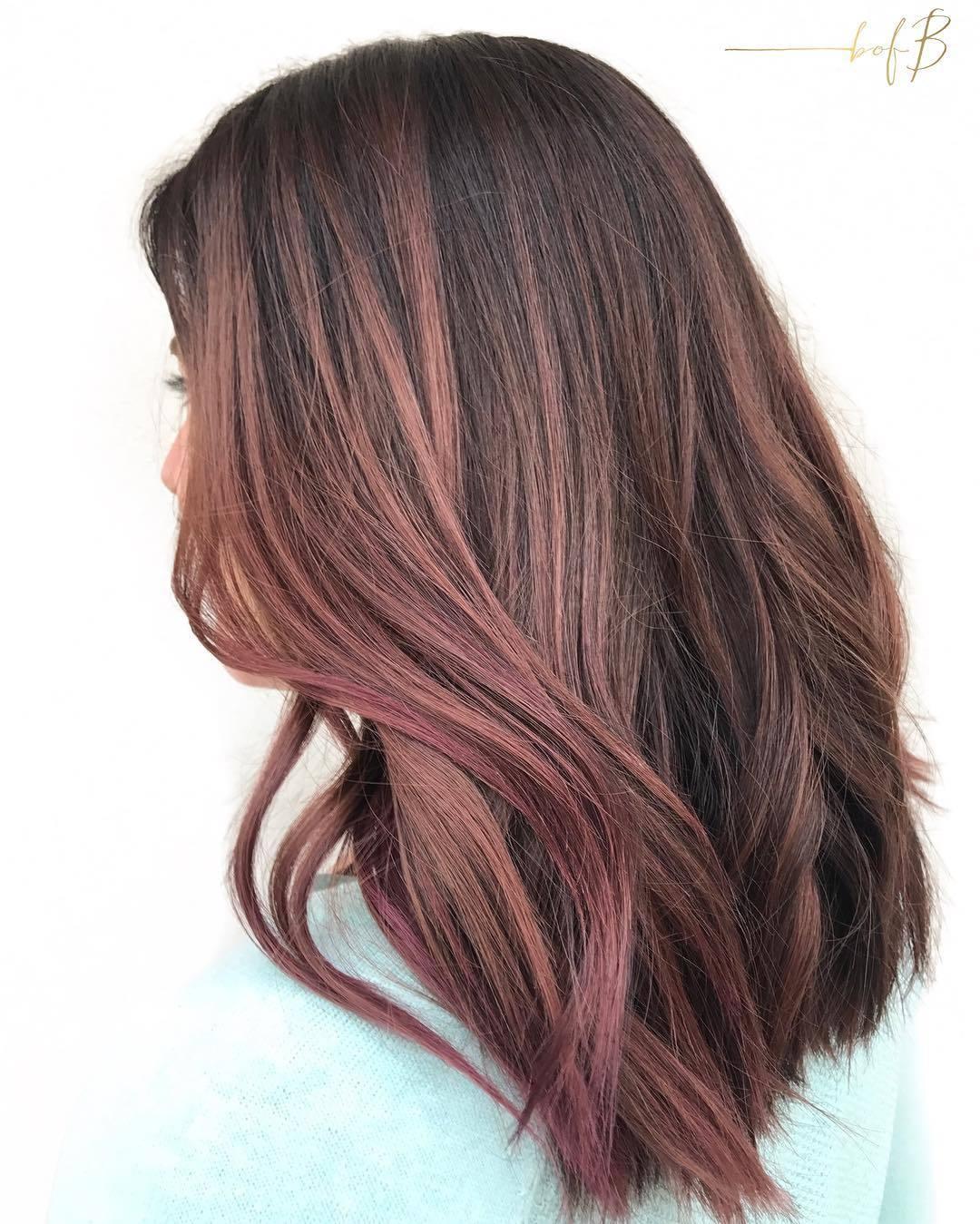 woman with long wavy chocolate mauve hair