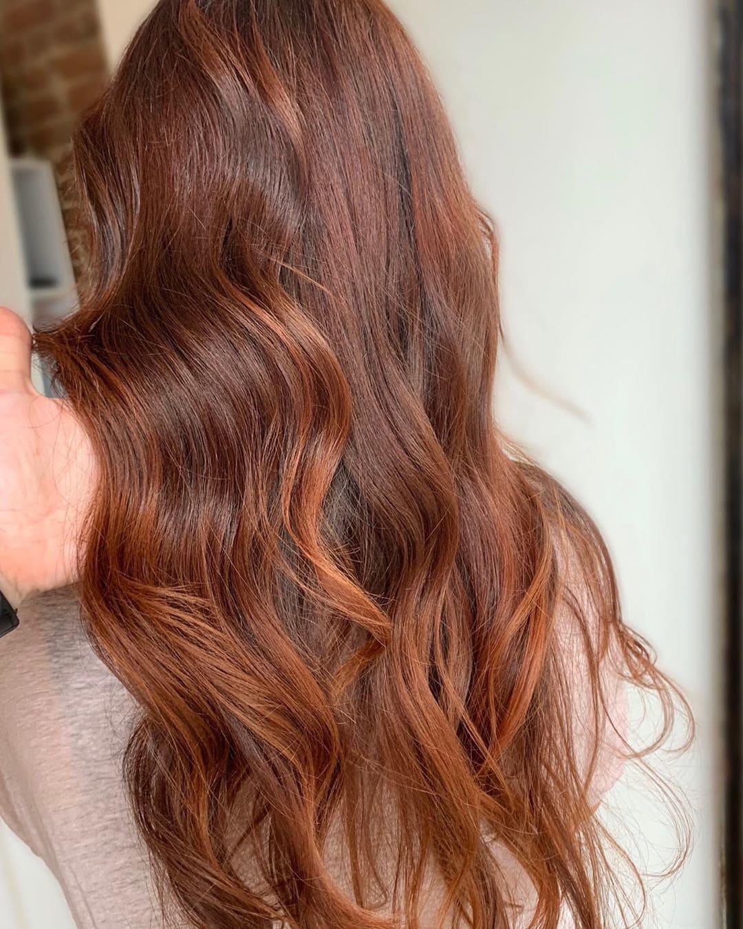 woman with long cinnamon hair