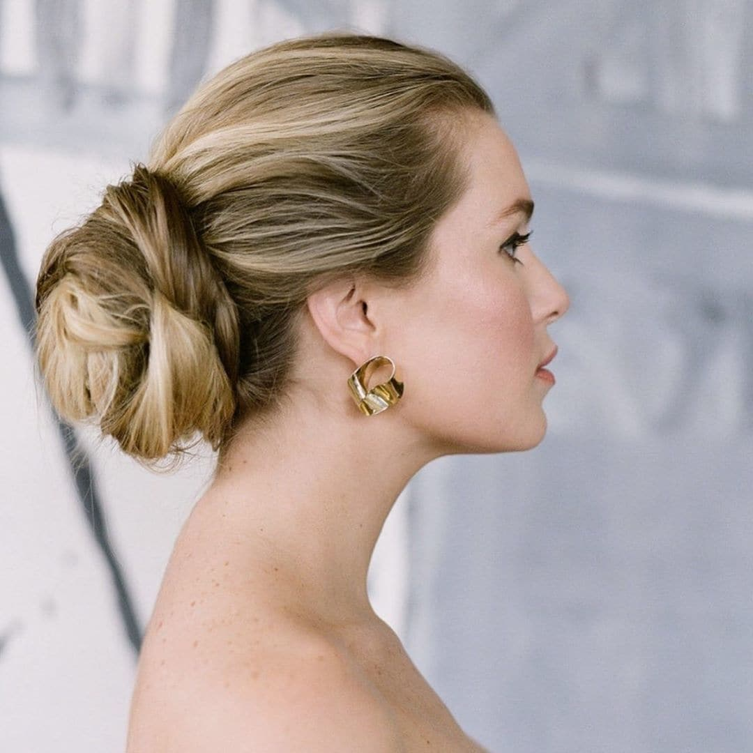 Woman with blonde hair in low bun