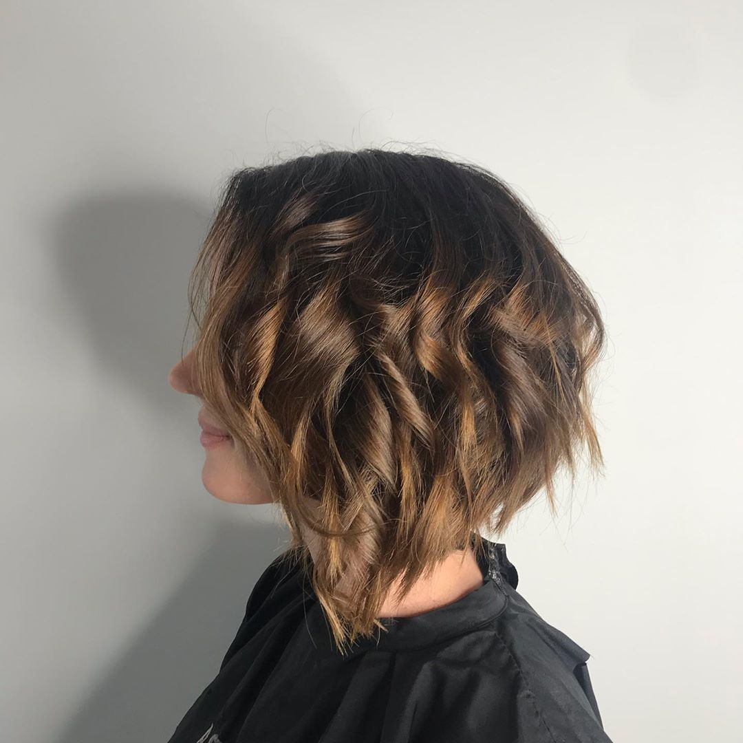 Brunette woman with a wavy concave bob