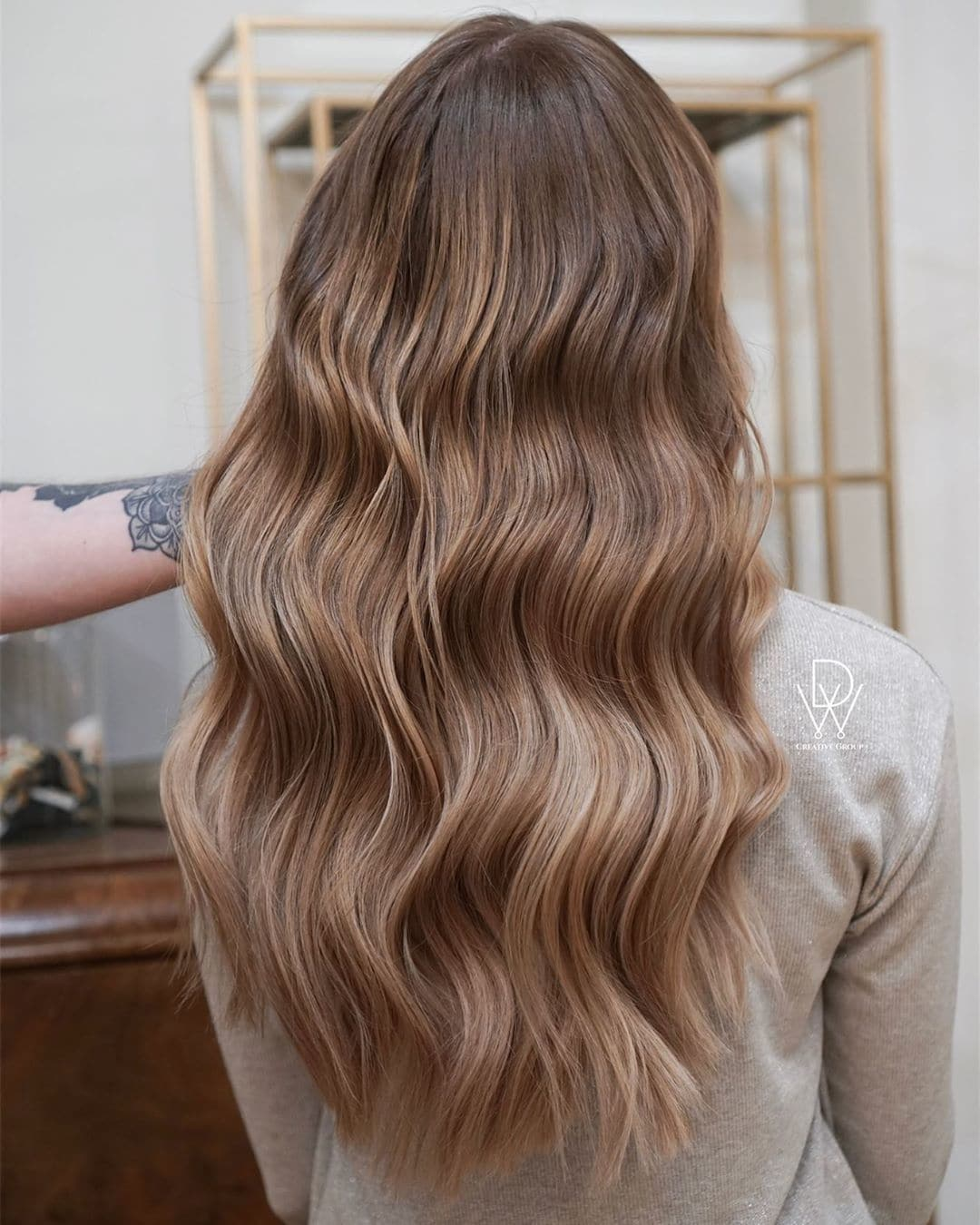 woman with long wavy dark blonde hair