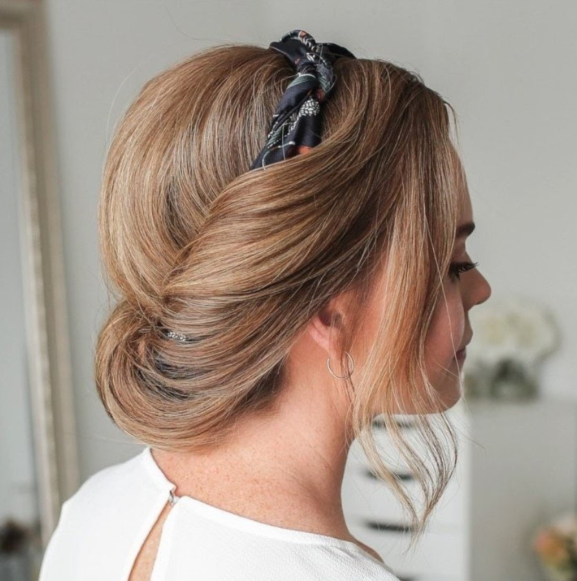 woman with bronde hair styled into headband tuck