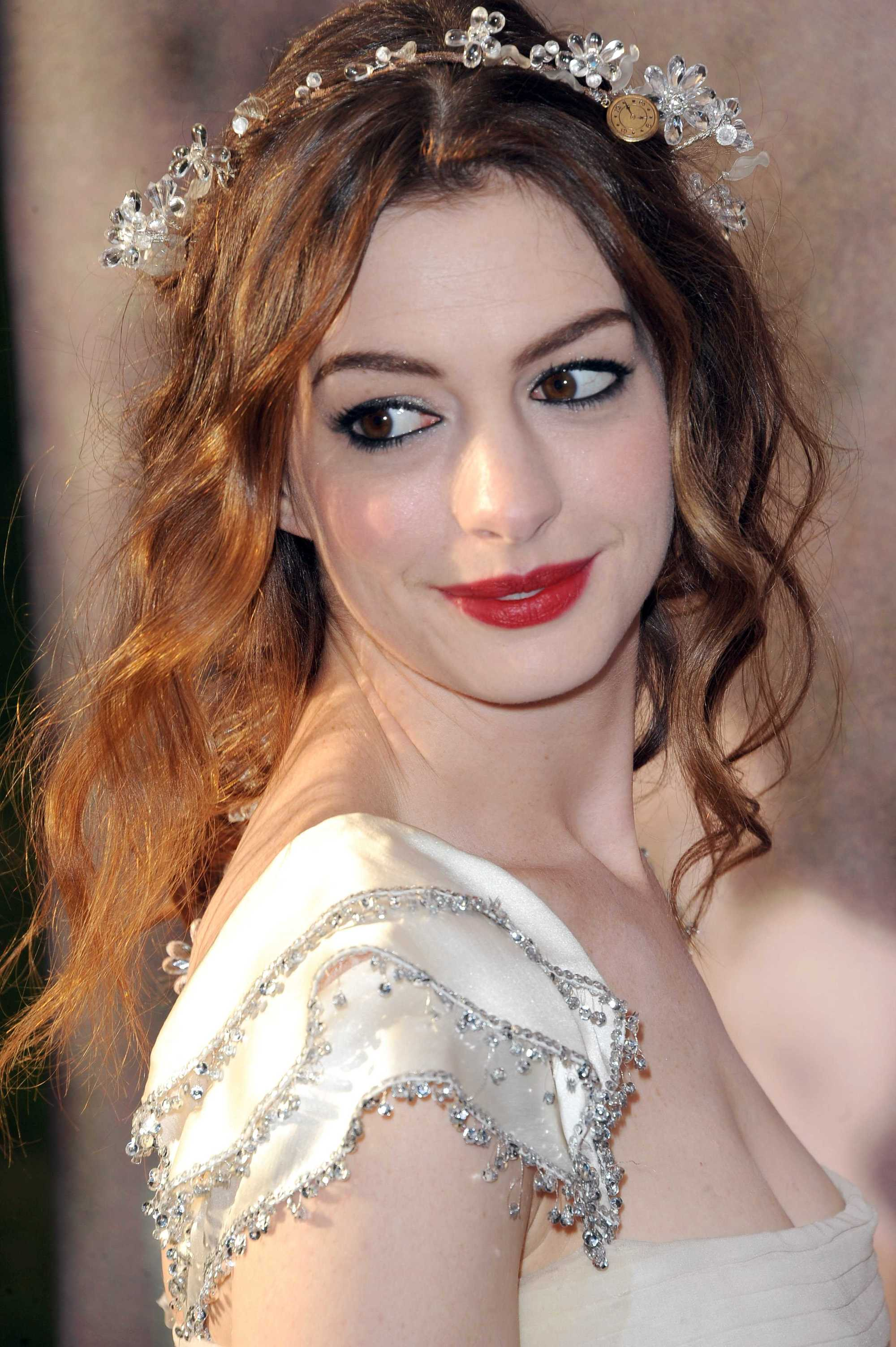 Anne Hathaway with loose updo with flower crown headband