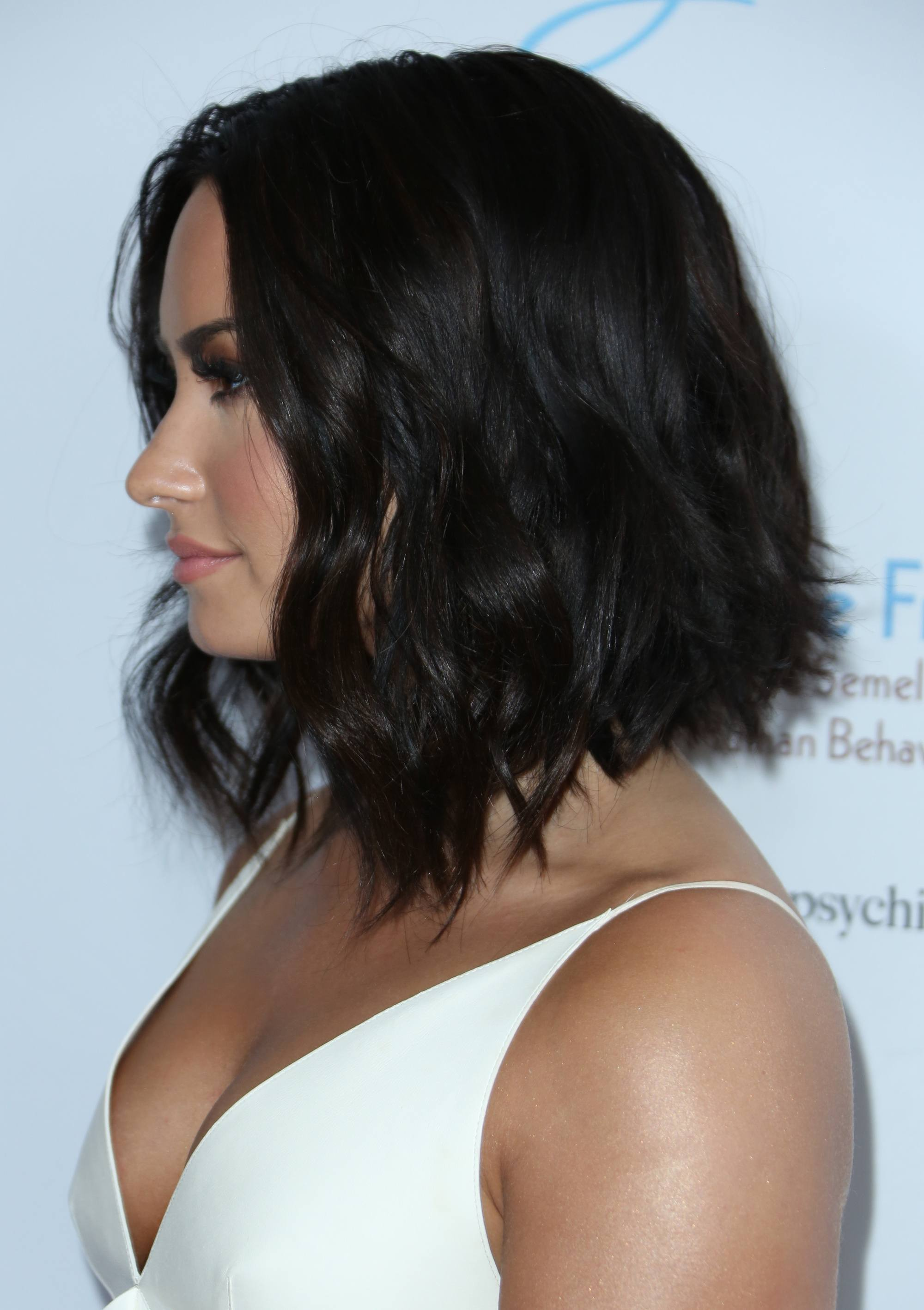 Demi Lovato with a black wavy graduated bob