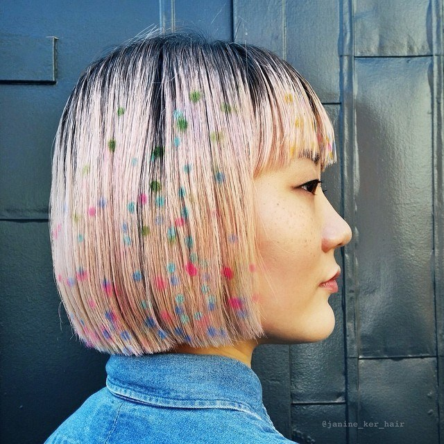woman with pink bob with bangs with graffiti polka dots