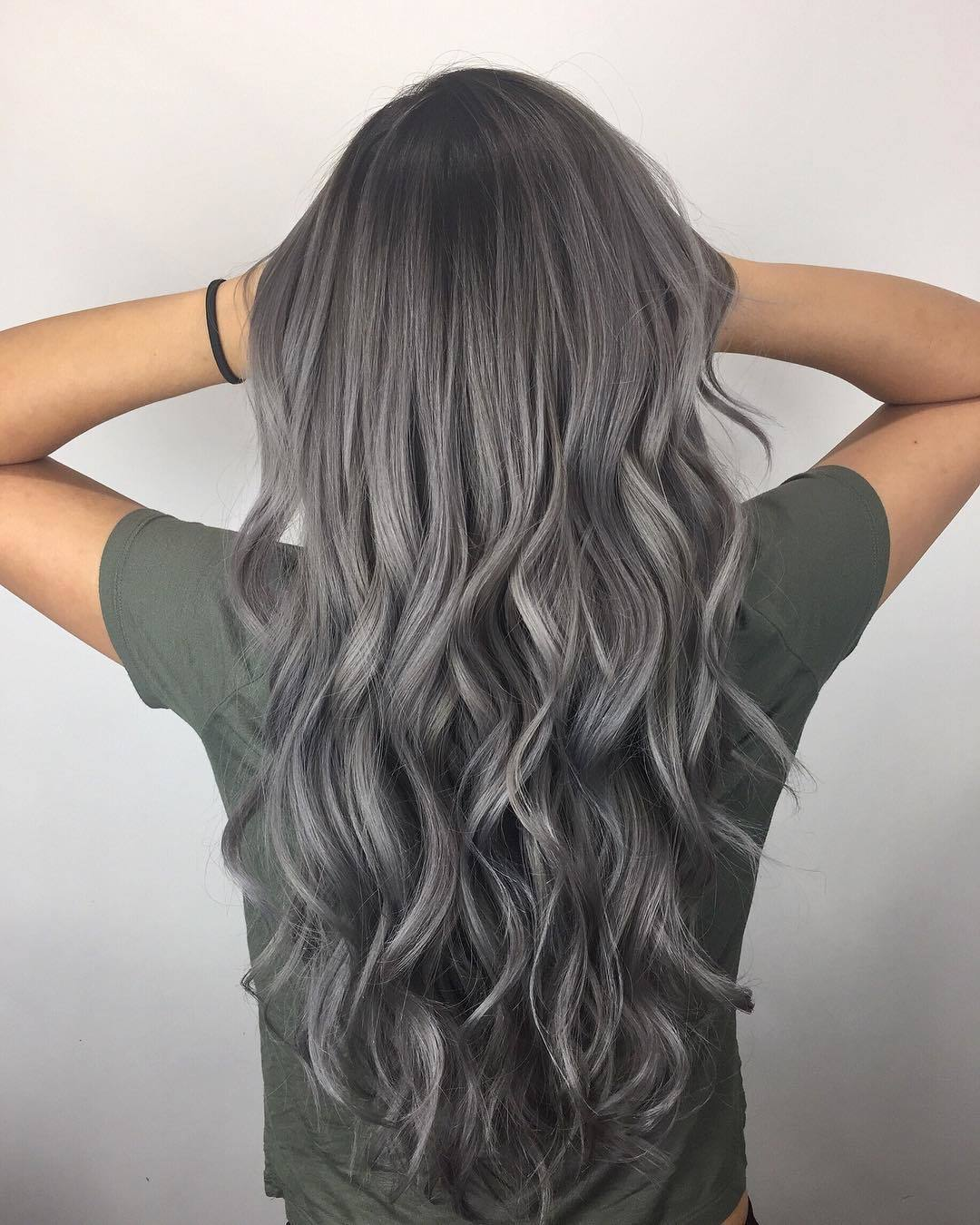 woman with long curly grey hair